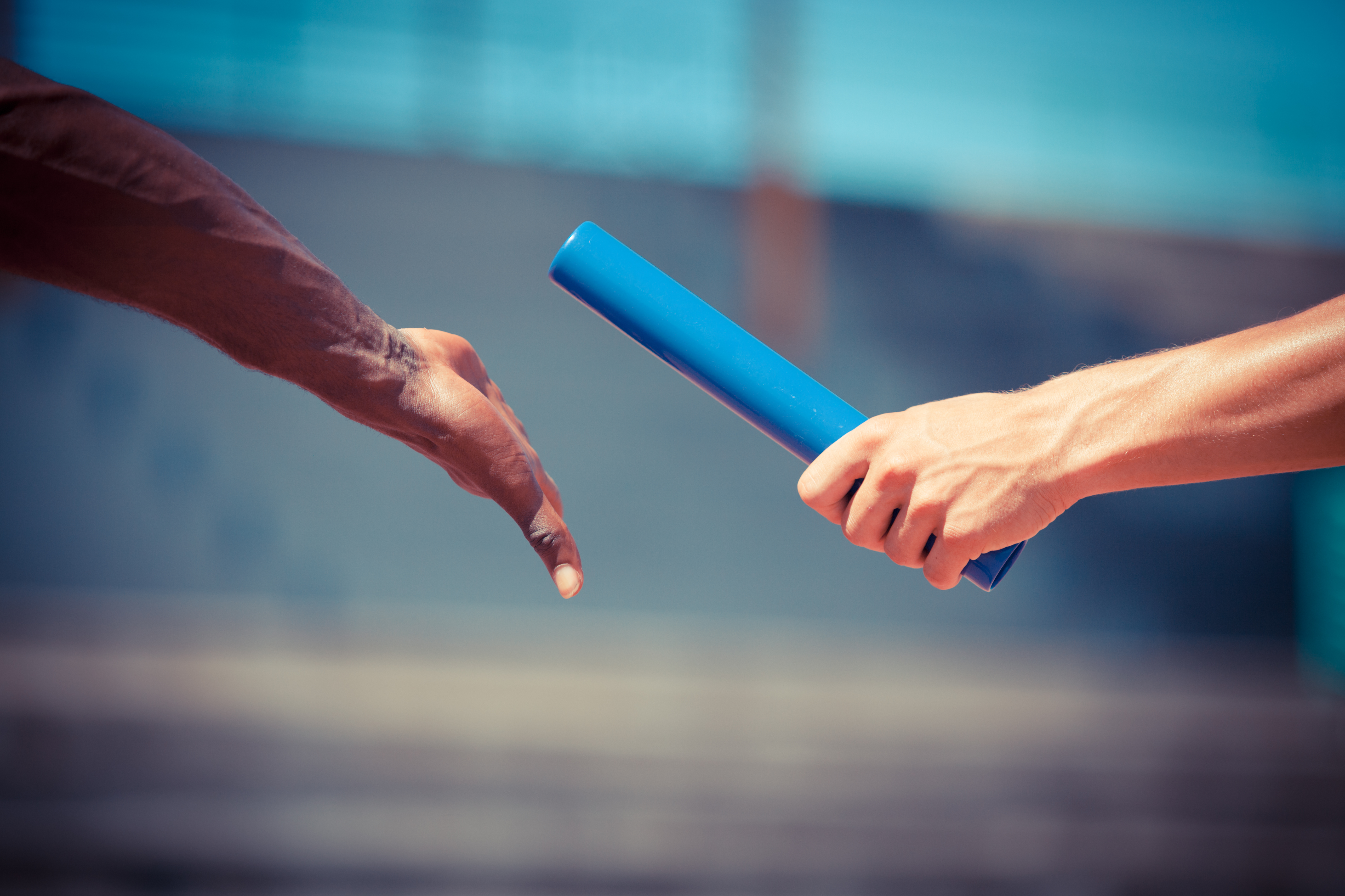 passing the baton during a relay race