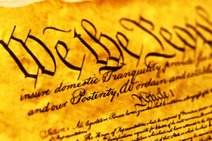 Closeup of the US Constitution beginning with We the People