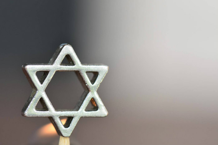Silver Star of David against a blurred greyish background