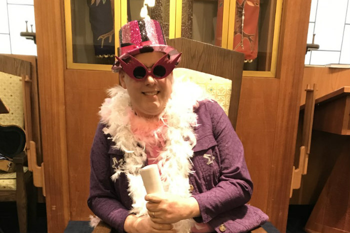 The late Joseph Dropkin dressed up on a pink hat glasses and feather boa for an annual Purim spiel