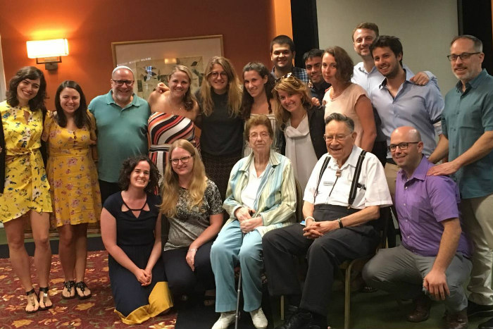 Betty Roswell and her husband Arthur surrounded by Roswell Klal Yisrael Fellows