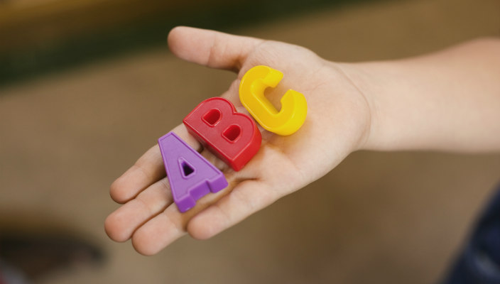 Block letters -- A-B-C -- in an outstretched palm