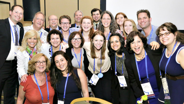 Group of about two dozen smiling faces at the 2015 URJ Biennial
