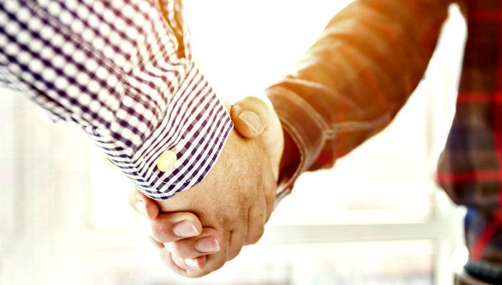 Closeup of a handshake between two men
