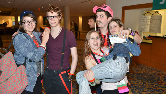 A group of teens laughing together in costume at NFTY Convention