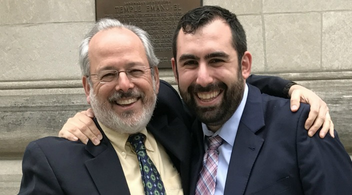 Author Rabbi Billy Dreskin and his mentee Rabbi Jason Fenster smiling with their arms around one another in celebration of Rabbi Fensters ordination