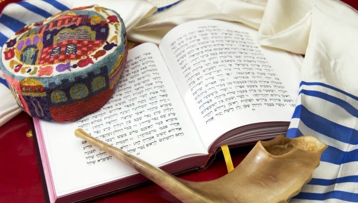 Tallit, machzor (High Holiday prayer book), traditional head covering, and shofar