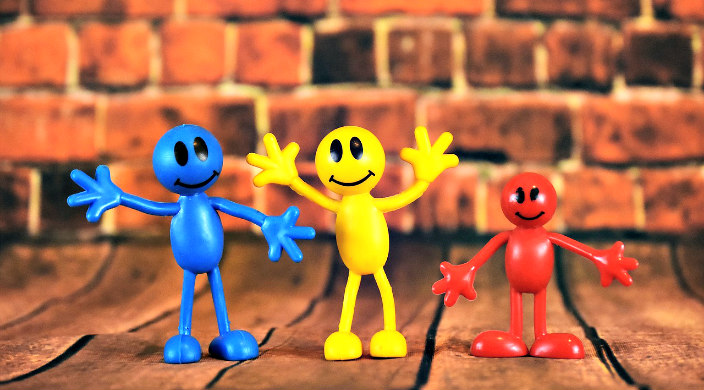 Bendy childrens toys in primary colors with cartoony smiling faces