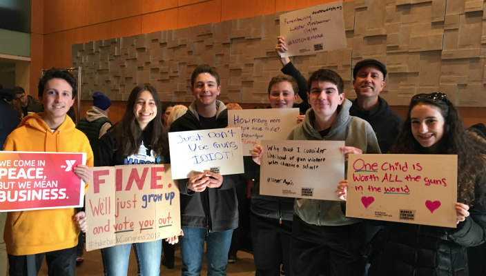 Students with gun violence prevention signs