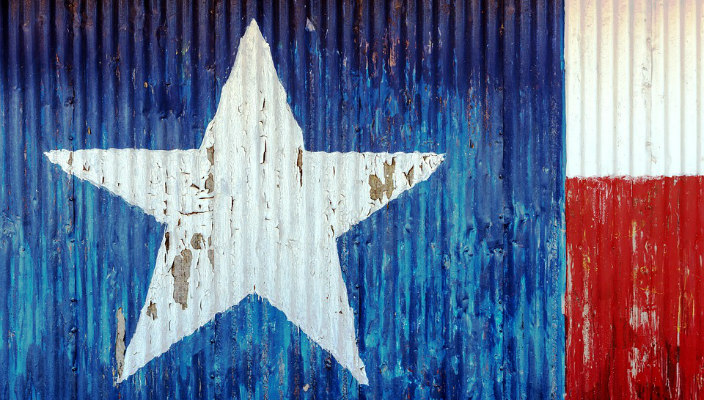 Texas flag painted onto textured aluminum