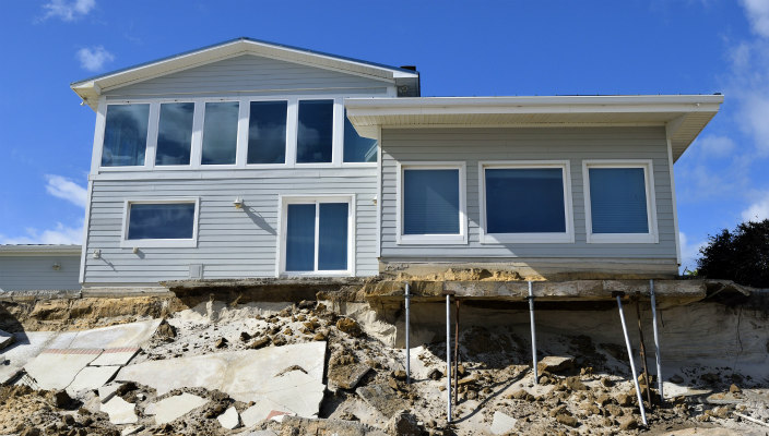 House with damage from hurricane/beach erosion