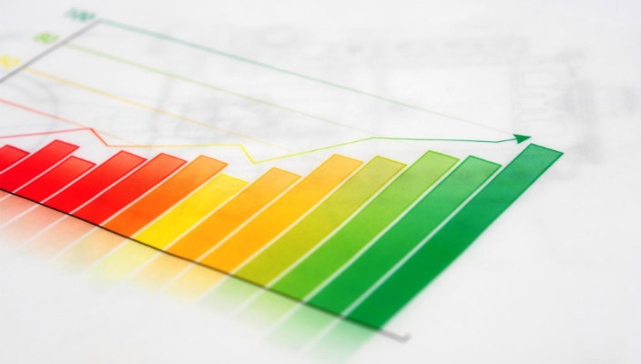 Colorful image of a data growth chart against a white background as if on a desk