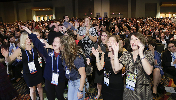 Group of people smiling and dancing at the 2015 URJ Biennial