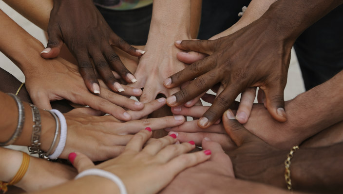 A group of hands of people of all races