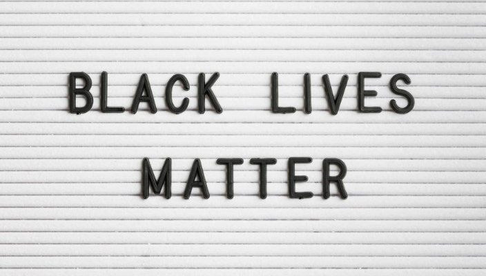 White letterboard with the words BLACK LIVES MATTER in black plastic letters
