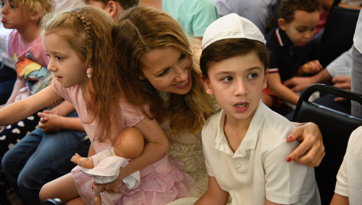 Mother and two children at Chofshi B'Manhattan event at Stephen Wise Free Synagogue in New York, NY