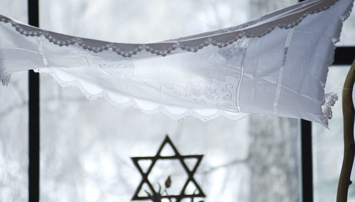 White lace chuppah with Star of David below