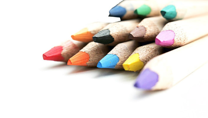 Pile of sharpened colored pencils against a white background