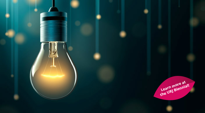 Lightbulb surrounded by smaller lights