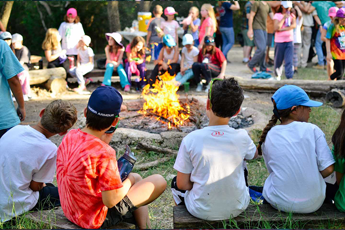 Campers enjoying music by the fire at URJ Greene Family Camp