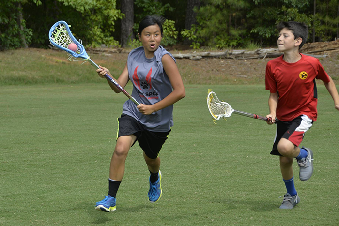 Campers playing lacrosse at Six Points Sports Academy