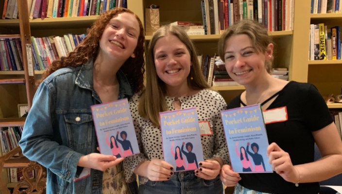 Three smiling teen participants in the Kol Koleinu feminism fellowship