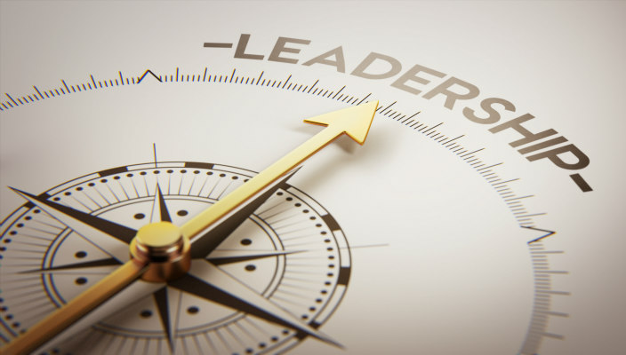 "Compass with the arrow pointing at the word ""Leadership"""