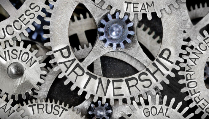 Interlocking gears; the main one of which says: Partnership