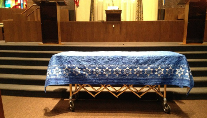 The pall covering a coffin in the sanctuary of Temple Isaiah in Lexington, MA