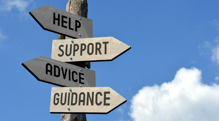 Sign-post with these signs: help, support, advice, guidance