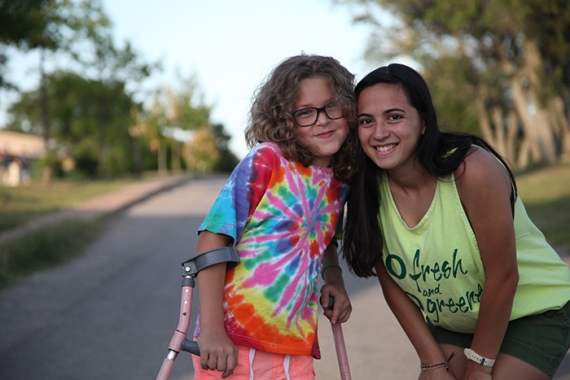 counselor and URJ camper using crutches