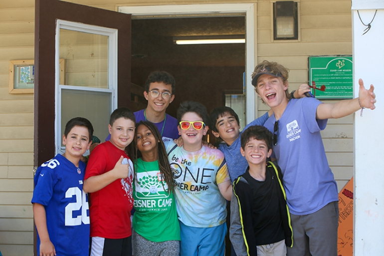 Campers welcoming others at URJ Camp Eisner