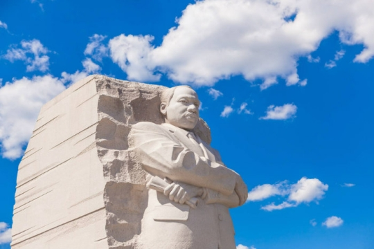 MLK monument in Washington DC against a cloudy blue sky
