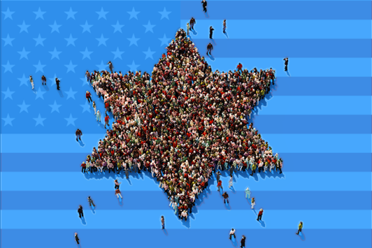 People standing in formation of a Jewish star with US flag in the background