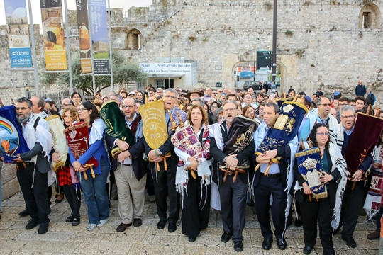 Reform Jewish leaders carrying Torahs at the Kotel in Israel