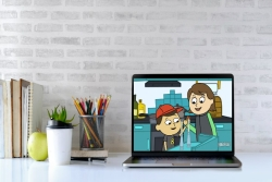 Bright and airy desktop with a laptop screen open to an animated Shaboom Shabbat video