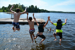 campers jumping into the lake at URJ Camp George
