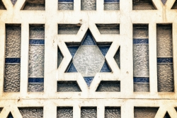 Stained glass window featuring a Star of David