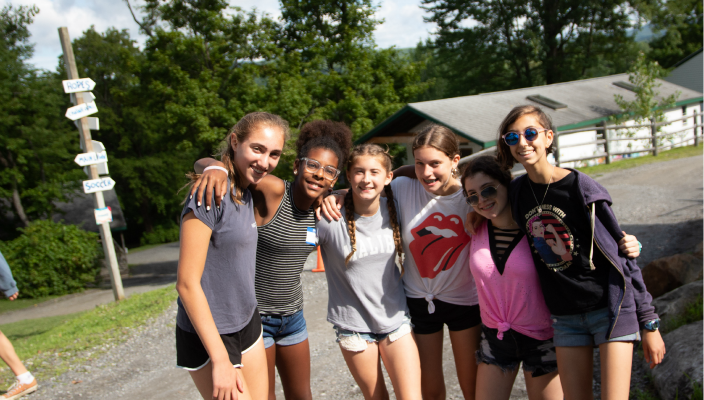 Happy teens posing together at summer camp