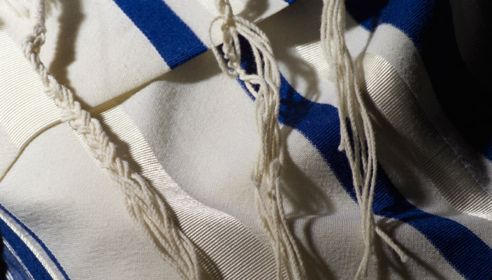Closeup of a blue and white prayer shawl