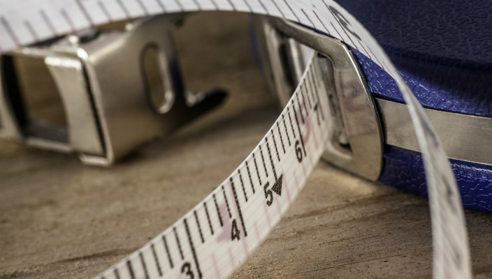 Close-up of tape measure partially extended from its case