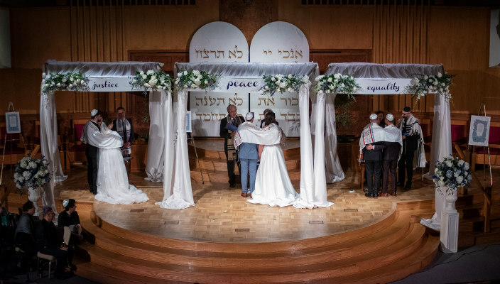 Three Israeli wedding couples under the chuppahs at Washington Hebrew Congregation on March 26, 2019