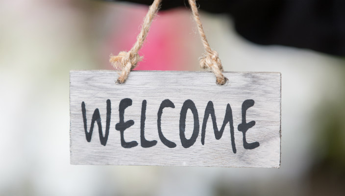 Rustic looking welcome sign hanging from twine
